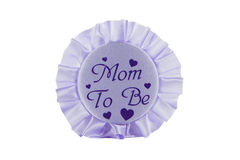 Mom to Be Button. A mom to be button against a white background Stock Photo