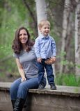 Mom with toddler boy. Toddler boy playing with his mom with mountains and outdoor backdrop Stock Photos