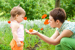 Mom and toddler in garden Stock Photo
