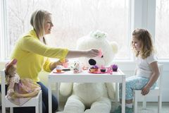 A mom and toddler having a tea party royalty free stock image