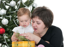 Mom and toddler at the new year tree Stock Images
