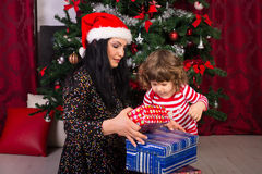 Mom and toddler opening Christmas presents Royalty Free Stock Photo