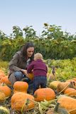 Mom and Toddler pumpkin farm stock image