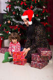 Mom and toddler son opening Christmas gifts Royalty Free Stock Photography