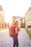 Mom is traveling with the child. Mom is traveling with the child who sits at the back royalty free stock image