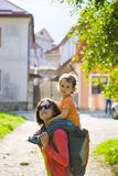 Mom is traveling with the child. Mom is traveling with the child who sits at the back stock photos