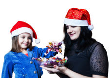 Mom treats her daughter candy Stock Image