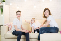 Mom with two children. Of twelve years and eleven months of age in the room royalty free stock photography