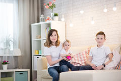 Mom with two children. Of twelve years and eleven months of age in the room stock photos