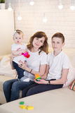 Mom with two children. Of twelve years and eleven months of age in the room royalty free stock photo