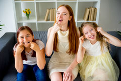 Mother and two daughters making faces Stock Image