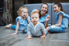 Mom, two daughters and a little son on the floor Royalty Free Stock Images