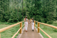 Mom and two daughters walking near the lake . Royalty Free Stock Photos