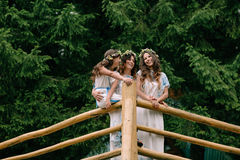 Mom and two daughters walking near the lake . Royalty Free Stock Photography