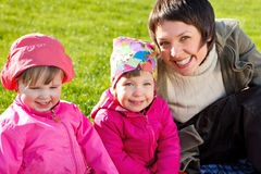Mom with two toddlers Royalty Free Stock Images