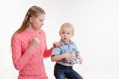 Mom unhappy child's behavior Stock Photography