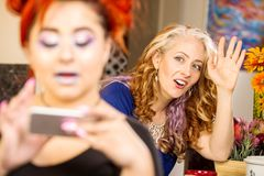Mom Vies for Daughters Attention stock images