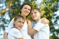 Mom on a walk with her kids. In summer Royalty Free Stock Photography
