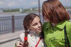 Mom walks with her daughter. Stock Photo
