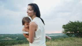 Mom walks with her son standing on the mountain stock footage