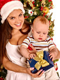 Mom wearing Santa hat holding  baby  under Stock Photo