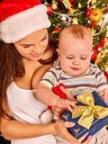 Mom wearing Santa hat holding  baby  under Royalty Free Stock Photography
