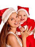 Mom wearing Santa hat holding  little baby son Royalty Free Stock Photography