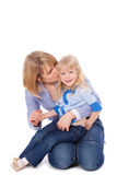 Mom whisper in child's ear. Isolated stock image