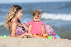 Mom With A Child In The Sand Royalty Free Stock Image
