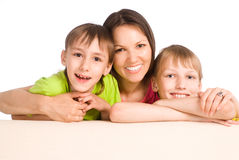 Mom With Kids On Sofa Stock Images