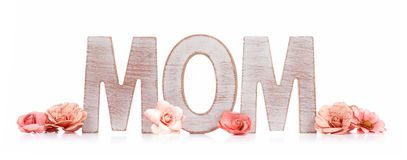 MOM wooden letters with paper flowers isolated on white Royalty Free Stock Photo