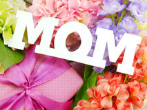 Mom word copy with gift and fllower Royalty Free Stock Image