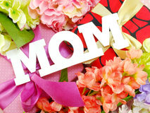 Mom word copy with gift and fllower Stock Photo