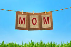 Mom word shape hanging with clothespin Stock Photos