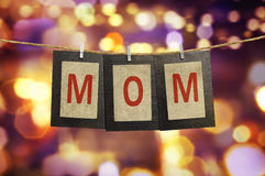 Mom word shape hanging with clothespin Royalty Free Stock Photography