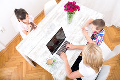 Mom working at home Stock Photos