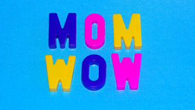 Mom/Wow. Mom with reflection of the word Wow. Abstract concept for Mother`s day Royalty Free Stock Photos