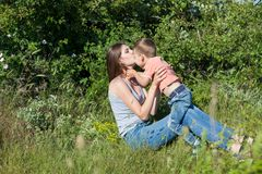 Mom and young boy son play park love stock image