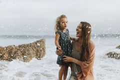 Mom with young daughter at a beach stock image