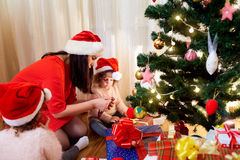 Mom with young girls getting ready for Christmas in the room wit royalty free stock photography