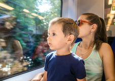 Mom and young son in an electric train Royalty Free Stock Images