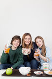Mom with your two sons drinking juice in the breakfast Stock Images