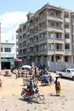 Mombasa's street. Mombasa road, a building under construction and sheet, some people on a motorcycle and a small open-air market as it is easy to see in Mombasa stock photos