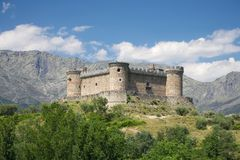Mombeltran castle and mountains Stock Photo