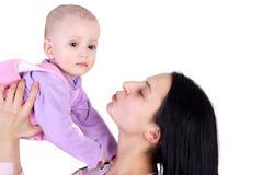 Momen och behandla som ett barn Arkivbilder