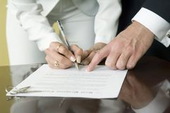 The moment. Close-up of a contract signing between a male and female business people