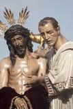 Moment av gåta av brödraskapet av St Benedict, helig vecka i Seville Arkivfoton