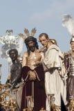 Moment av gåta av brödraskapet av St Benedict, helig vecka i Seville Royaltyfri Bild