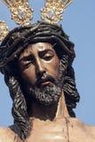 Moment av gåta av brödraskapet av St Benedict, helig vecka i Seville Royaltyfria Bilder