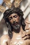 Moment av gåta av brödraskapet av St Benedict, helig vecka i Seville Arkivbild